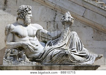 Statue Del Tevere In Rome, Italy