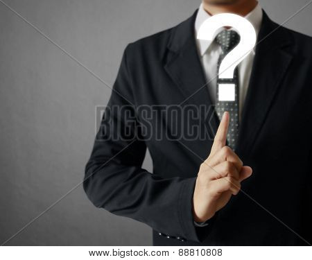 Business man holding question mark symbol