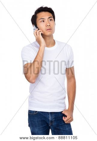 Young man talk to mobile phone