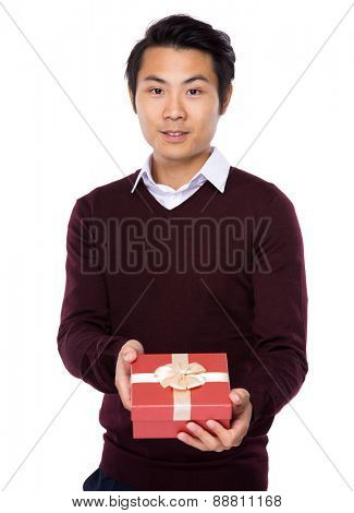 Young man show with gift box