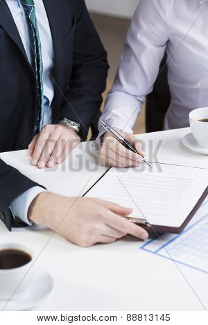 Businessperson Signing Important Document