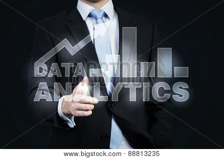 A Hologram Of Data Analytics And A Businessman Offering Handshake. A Concept Of Business Transaction