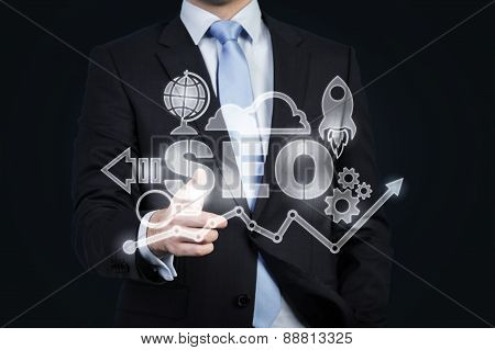 A Hologram Of Business Icons And A Businessman Offering Handshake. A Concept Of Business Transaction