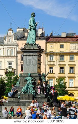 The Mickiewicz monument with tenement houses.