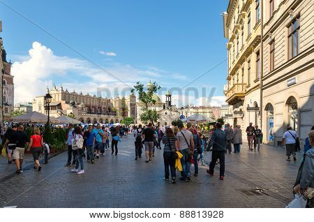 Tourists visiting the old town in Cracow, Poland.