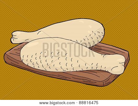 Turkey Drumsticks On Cutting Board