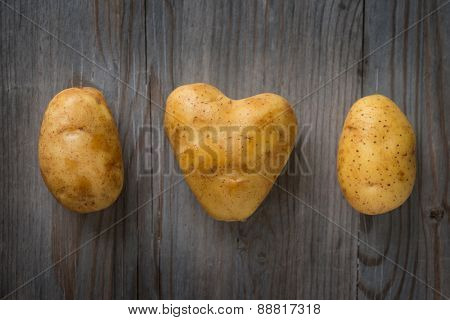 Golden potatoes on Wooden Table Background, Concept and Idea of Food Cook Rustic Still life Style. Dramatic light table setting.