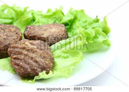 veal cutlet with lettuce on white background