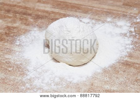 Sprinkle flour on dough