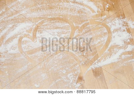 heart on desk and flour