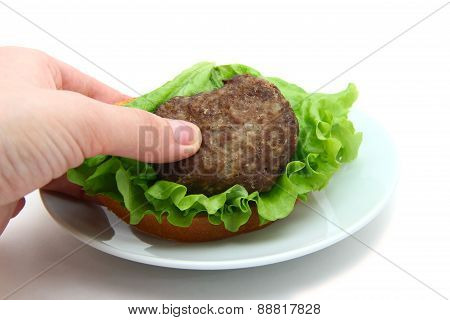 sandwich with cutlet in hand