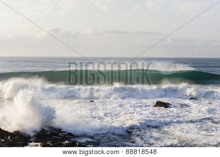 Wave Crashing Rocky Coastline