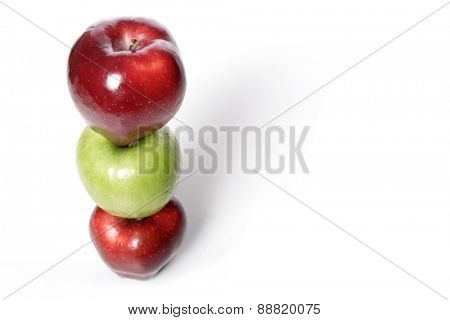Photo of three apples in stack