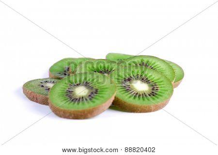 Slices of kiwi on white background