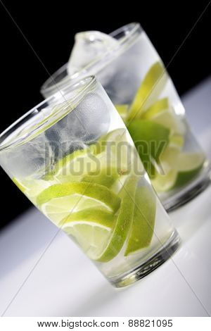 Studio shot of drinks with lime slices