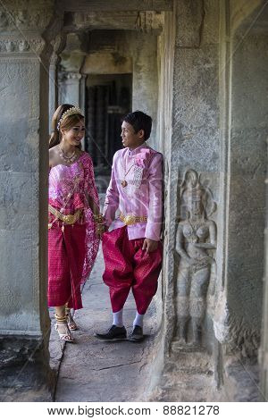 Cambodian Couple In Pink And Red Traditional Ceremonial Wedding Khmer Clothing At The Ancient Angkor