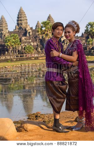 Cambodian Couple In Purple Traditional Ceremonial Wedding Khmer Clothing At The Ancient Angkor Wat T