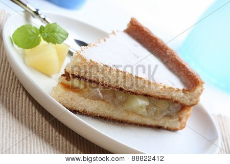 Close up of apple pie on white plate
