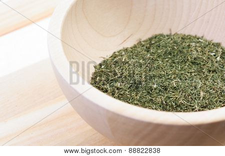 Dried thyme in wooden bowl