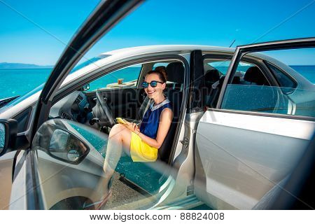 Woman with phone in the car