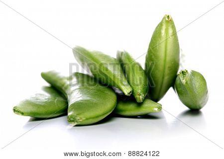 Close-up of peas on white background
