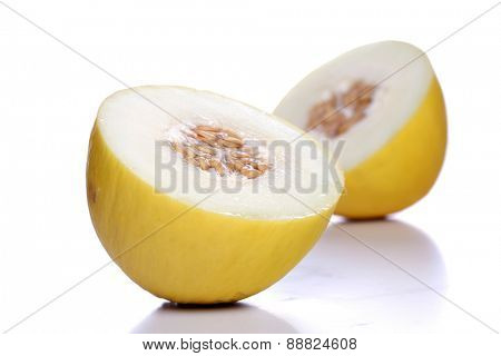 Halved melon on white background close up