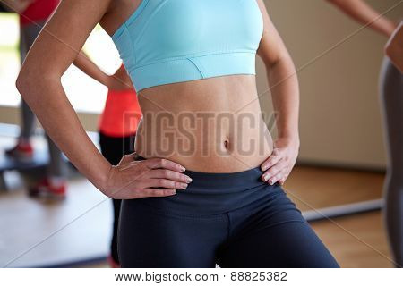fitness, sport, training, people and lifestyle concept - close up of women working out in gym