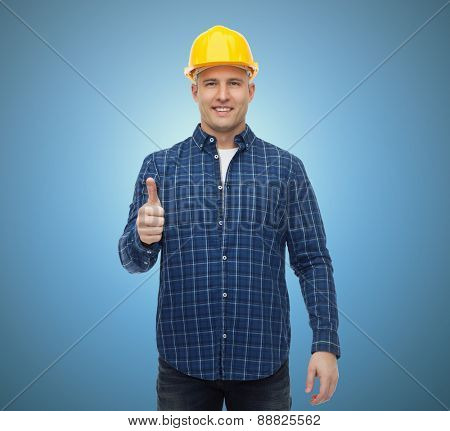 repair, construction, building, people and maintenance concept - smiling male builder or manual worker in helmet showing thumbs up over blue background
