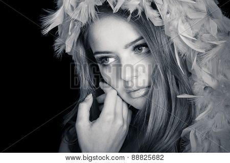 Young beautiful woman thinking, slightly toned black and white portrait