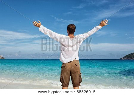 happy young man on the beach