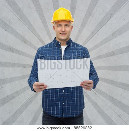 repair, construction, building, people and maintenance concept - smiling male builder or manual worker in helmet with blueprint over gray burst rays background