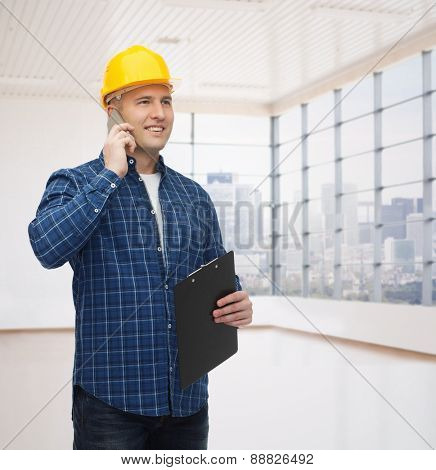 construction, building, people, technology and maintenance concept - smiling male builder or manual worker in helmet with clipboard calling on smartphone over empty flat background
