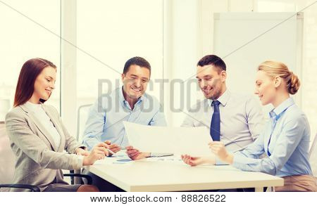 business and office concept - smiling business team having discussion in office