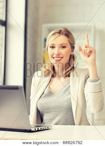 happy woman with laptop computer and finger up