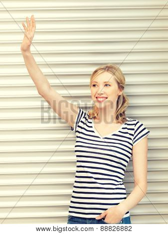 picture of happy teenage girl waving a greeting