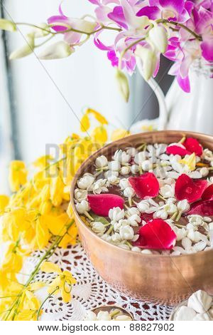 Water in bowl mixed with perfume and flowers, Songkran festival in Thailand.
