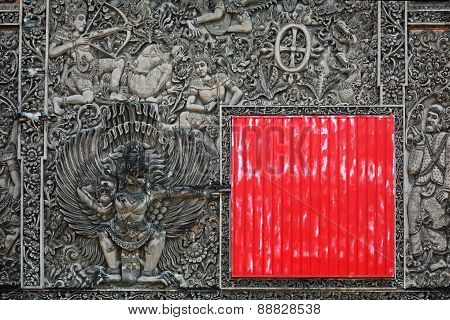 Ancient Balinese Stone Carving Background With The Red Square Shield