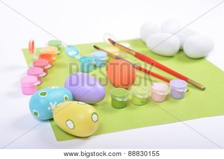 Paintbrushes And Paints For Coloring Wooden Eggs