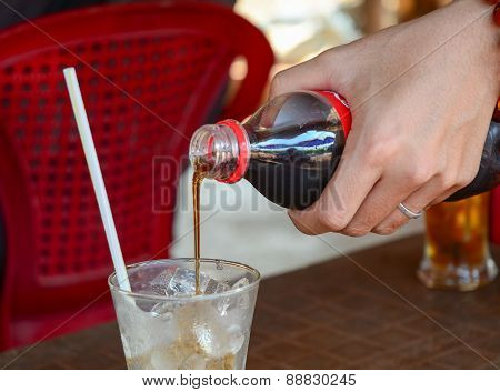 Pouring Cola Into The Glass