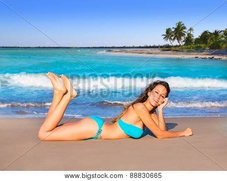 Brunette tourist lying in beach sand tanning happy in summer vacation Mexico palm tree photo mount