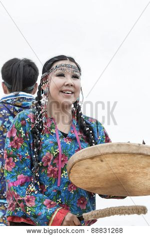 Expression woman dancing with a tambourine. Russia, Kamchatka