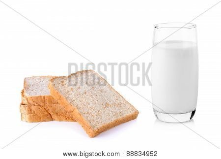 Fresh Milk In The Glass Wiht Whole Wheat Breadon White Background