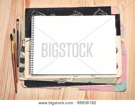 Notebook And Brushes