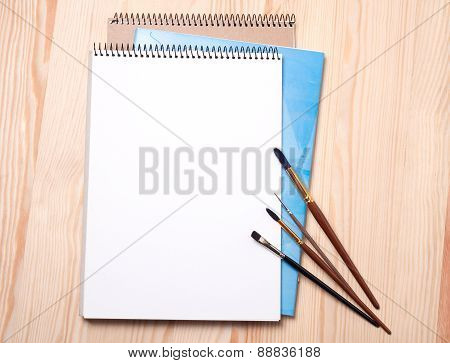 Blank Notebook And Brushes