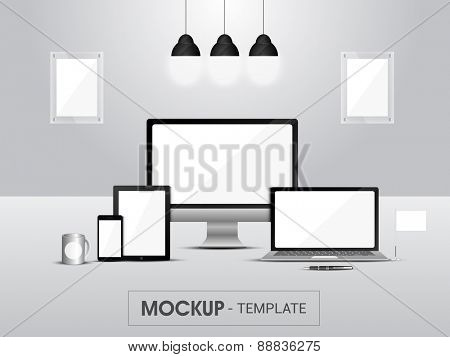 Blank mockup of digital devices in lamps lights on grey background for business or corporate sector.