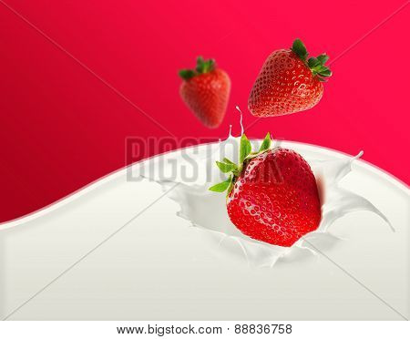 three strawberries falling into milk splash
