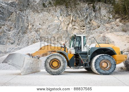 side view of large and heavy wheel mounted front loader at mine