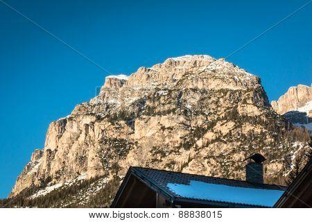 Mountain Peak With Shadow, Sun And Sky