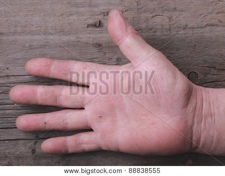Hand Worker On A Wooden Background