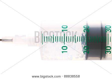 Medical Syringe On A White Background